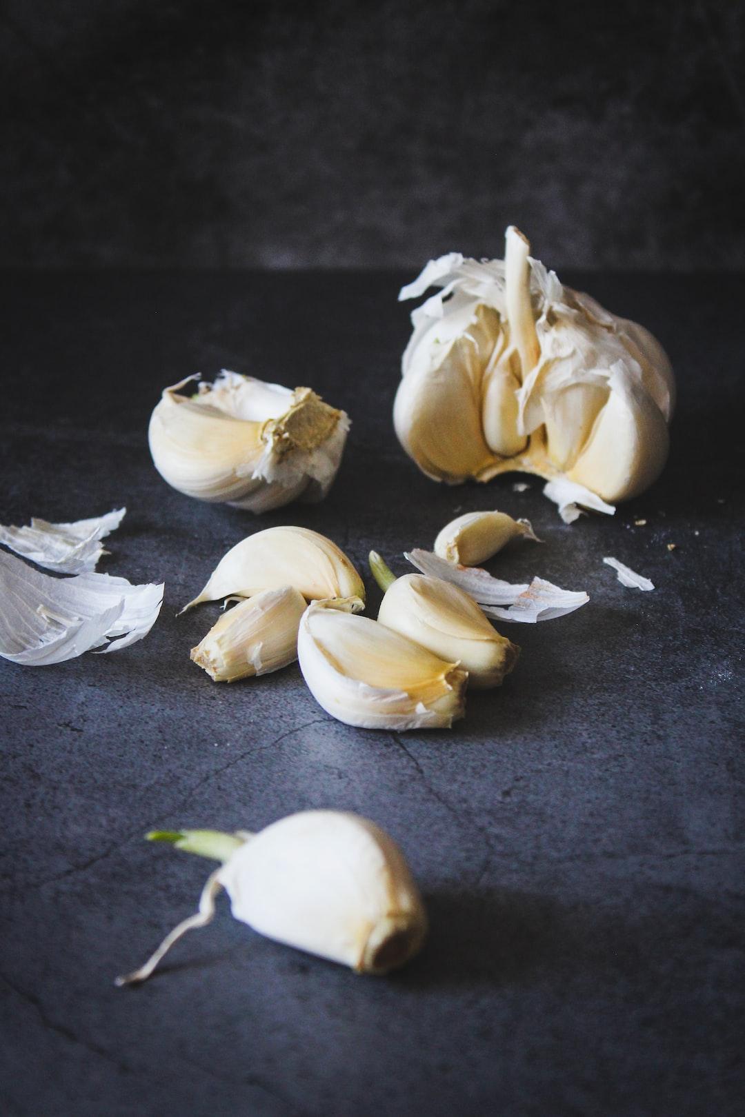 Fresh garlic on dark background