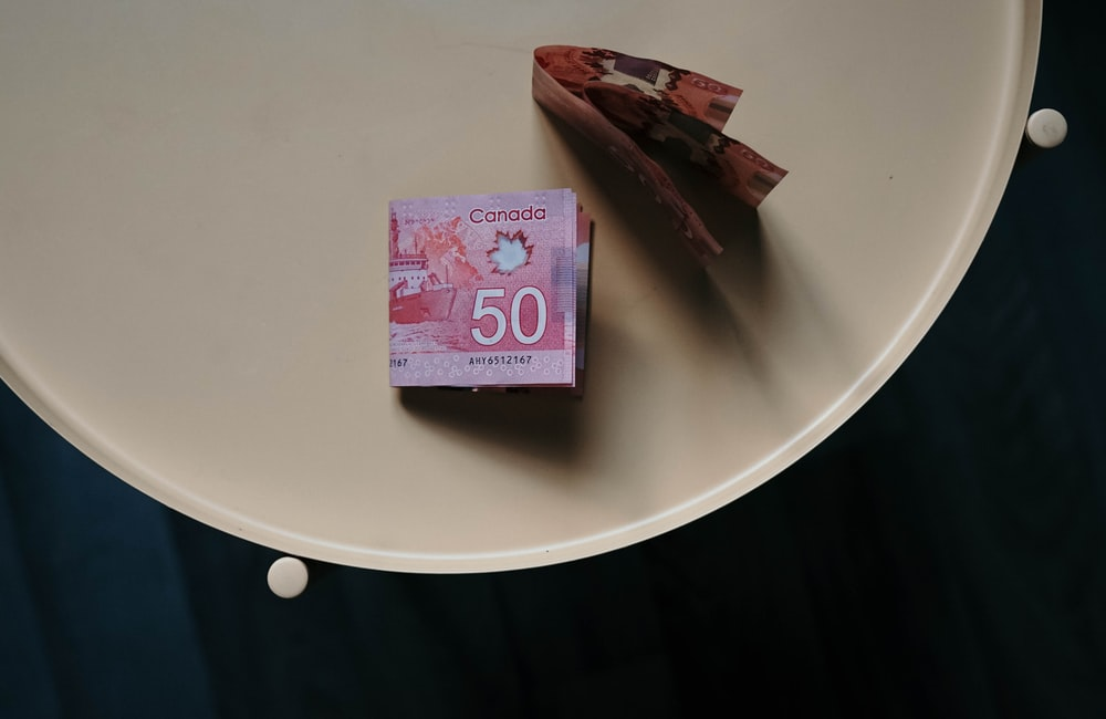 100 banknote on white round table