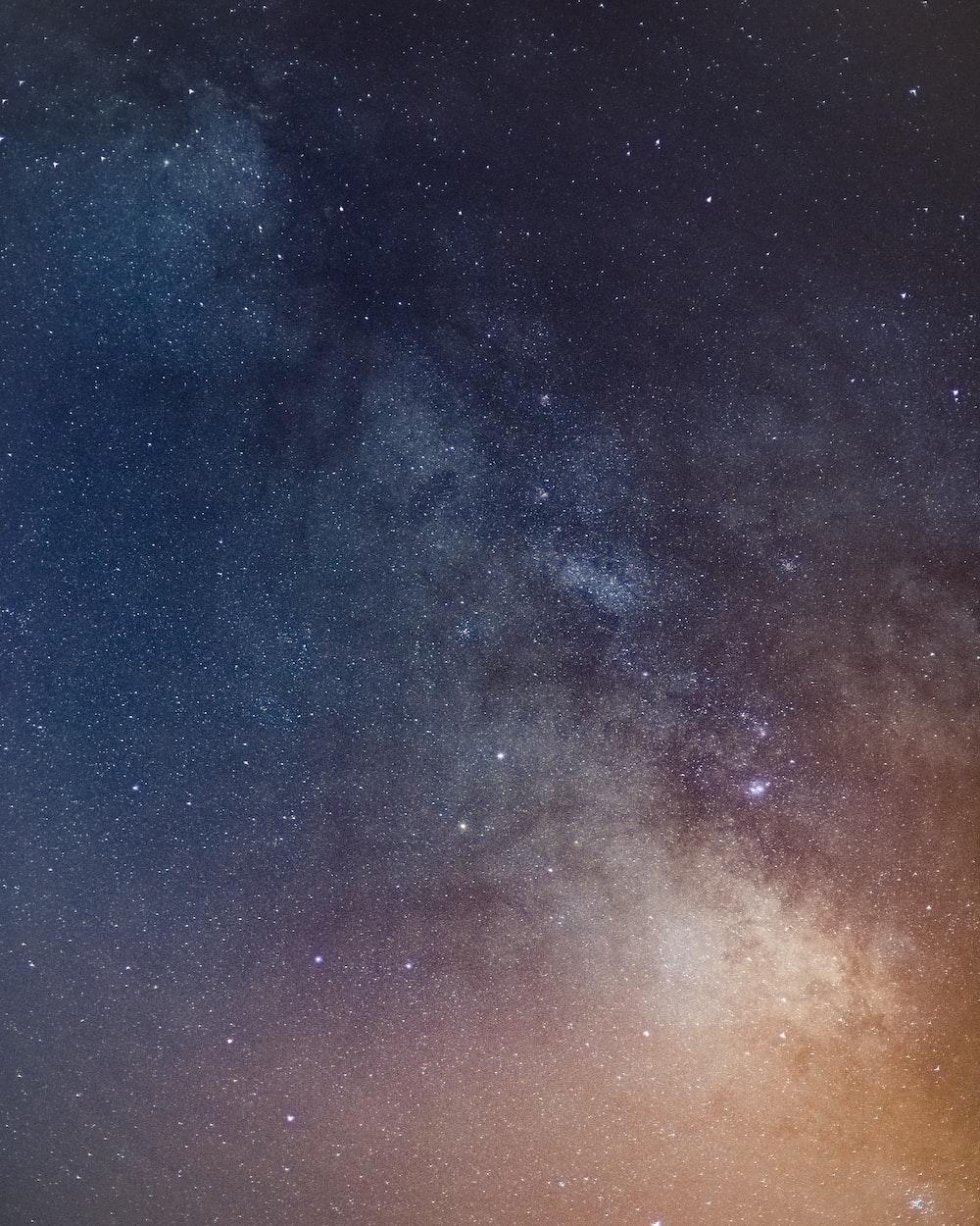 blue and orange starry night sky