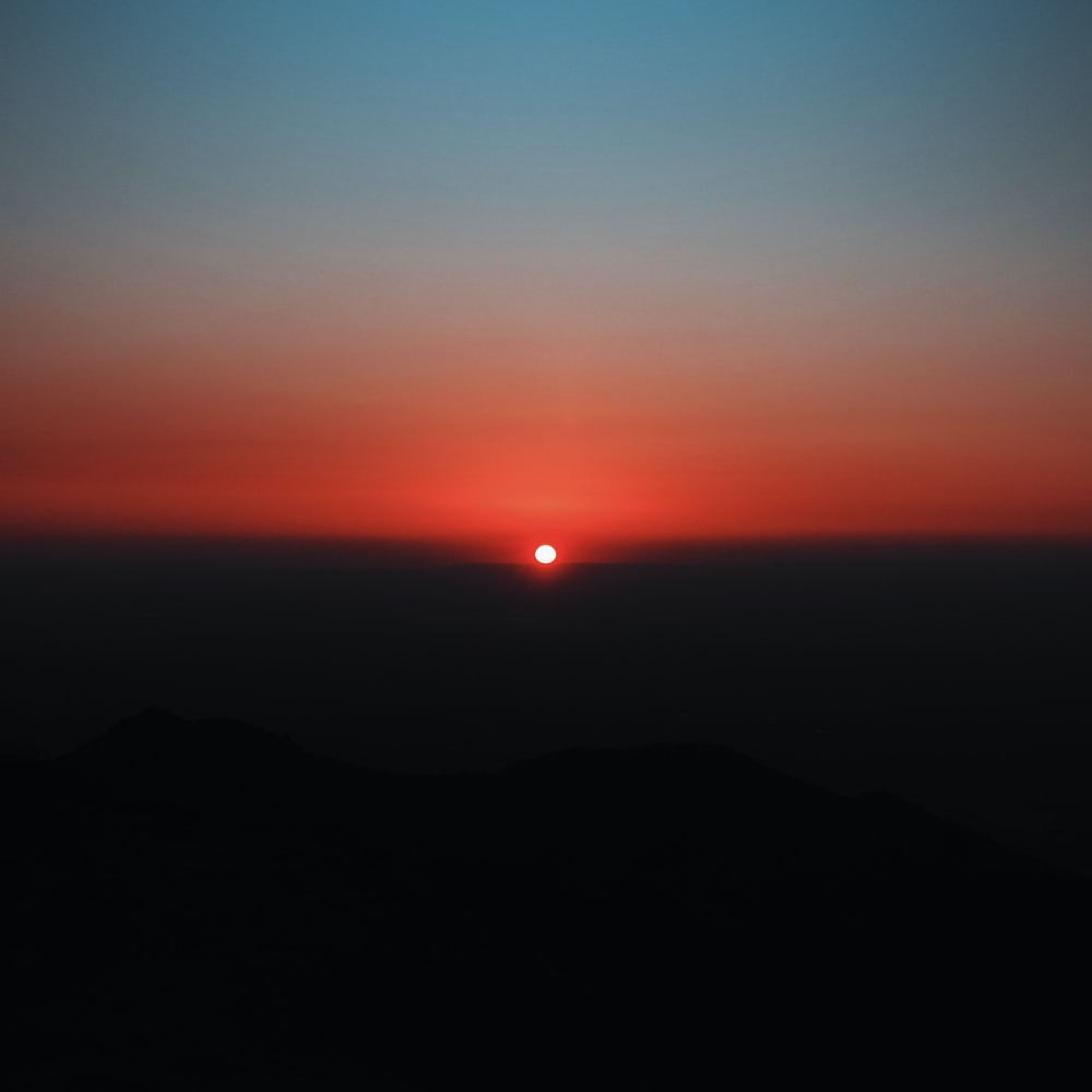 silhouette of mountain during sunset
