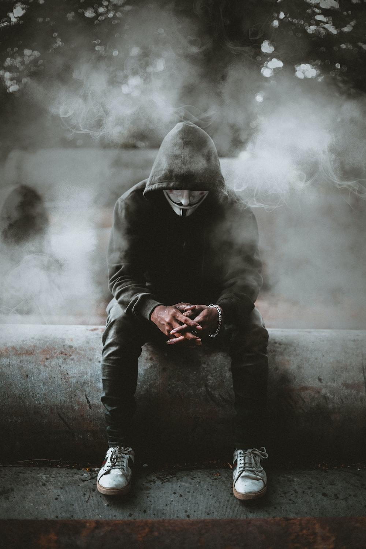 man in black hoodie and black pants