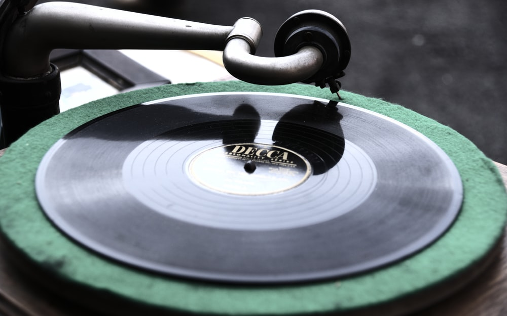 black and silver vinyl record player