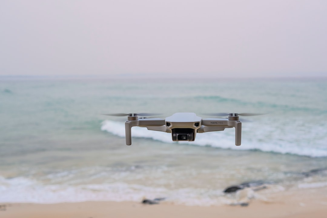 Close Up of Drone On Scenic Beach and Ocean. - unsplash