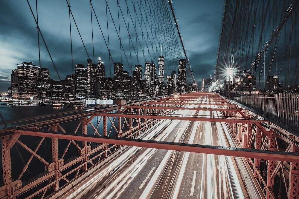 red metal bridge during night time