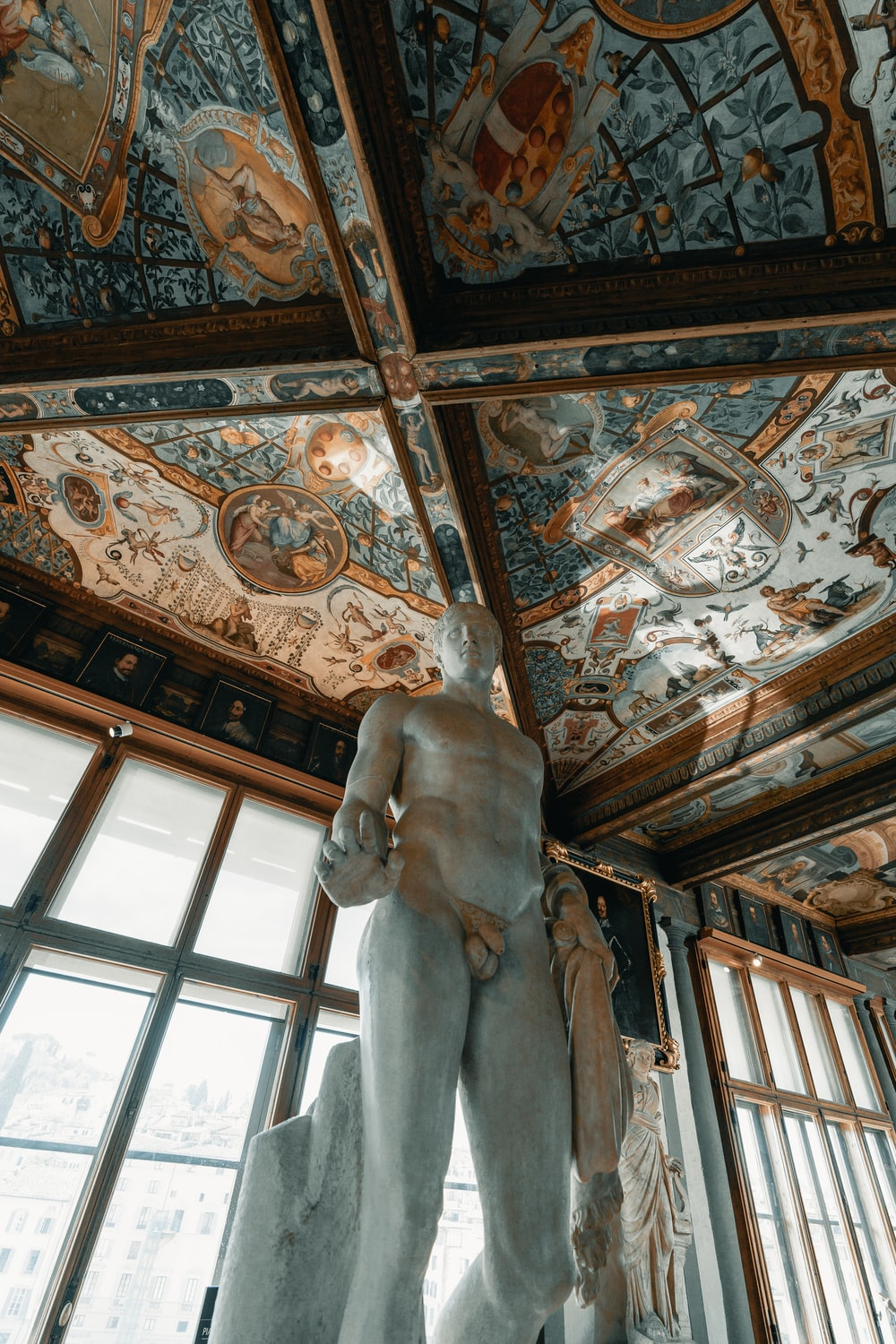 white concrete statue on brown wooden ceiling