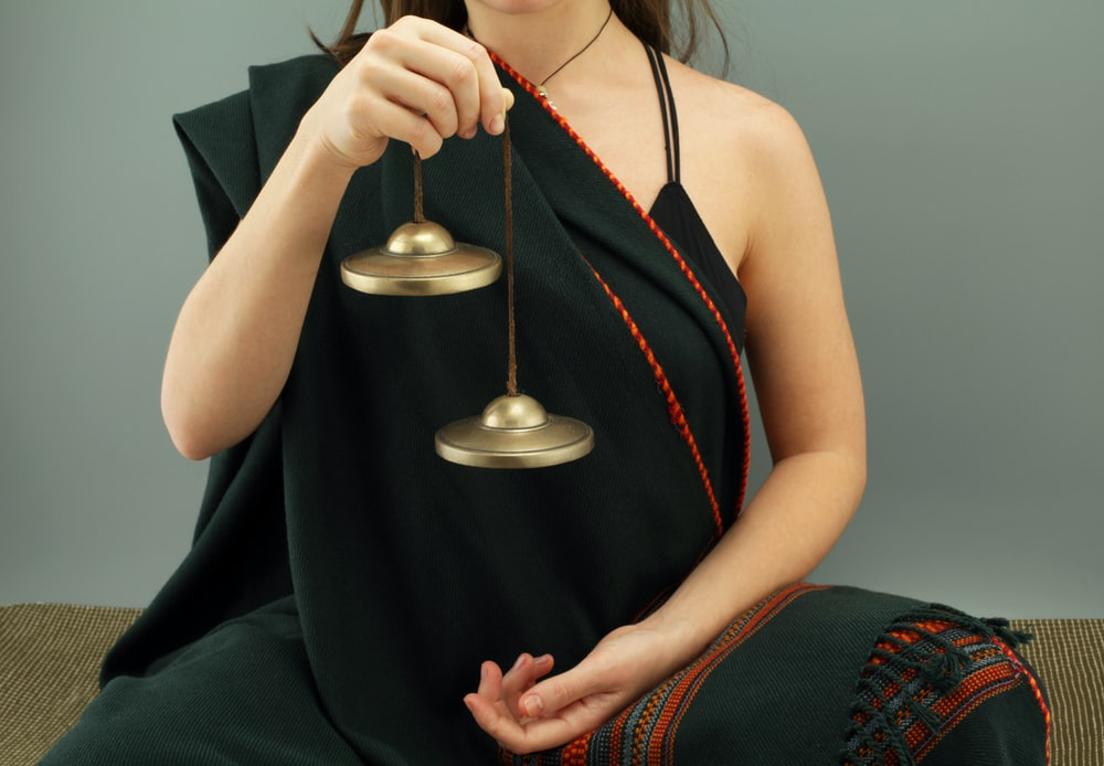woman in black tank top holding silver and gold trophy