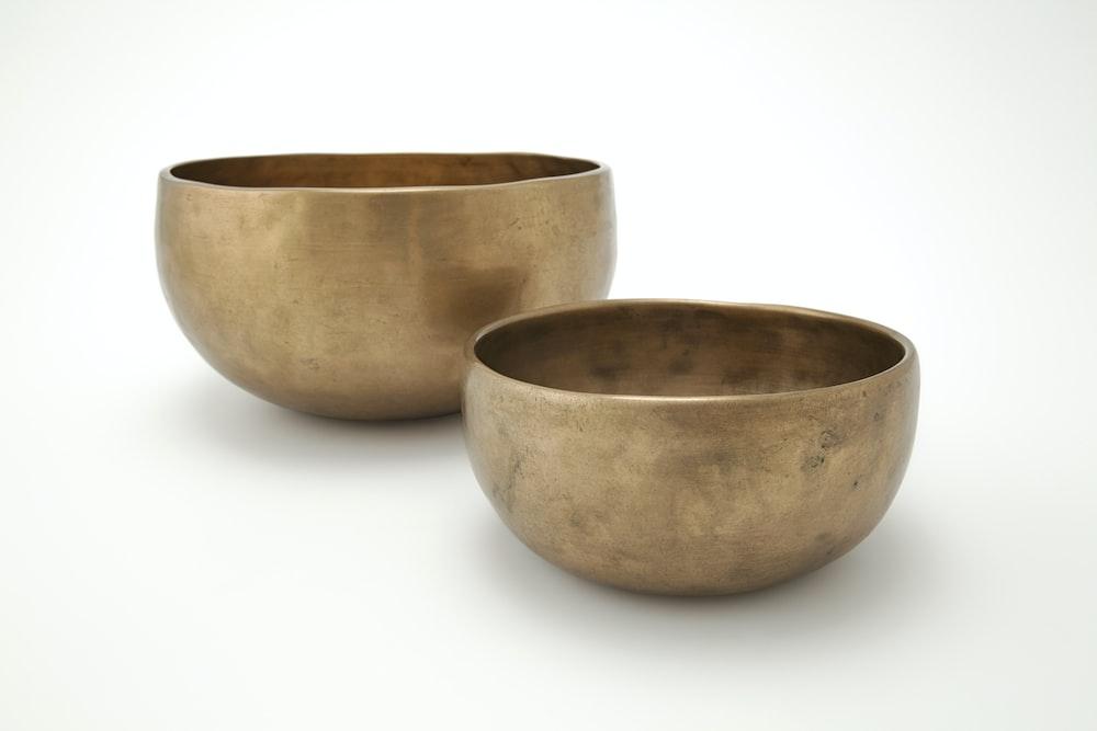 brown ceramic bowl on white surface