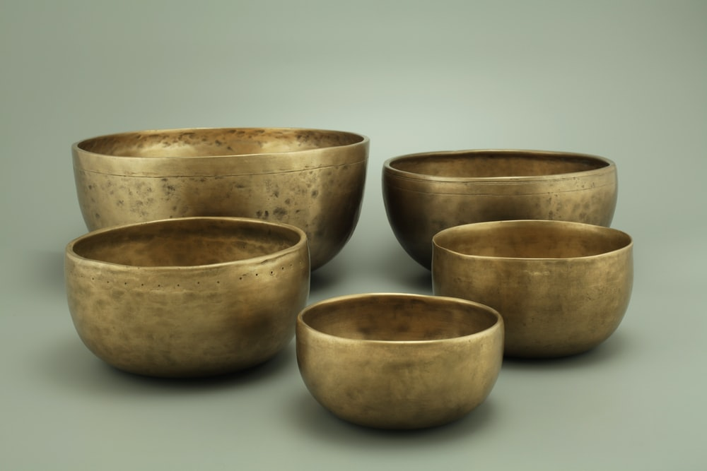 3 brown ceramic bowls on white surface