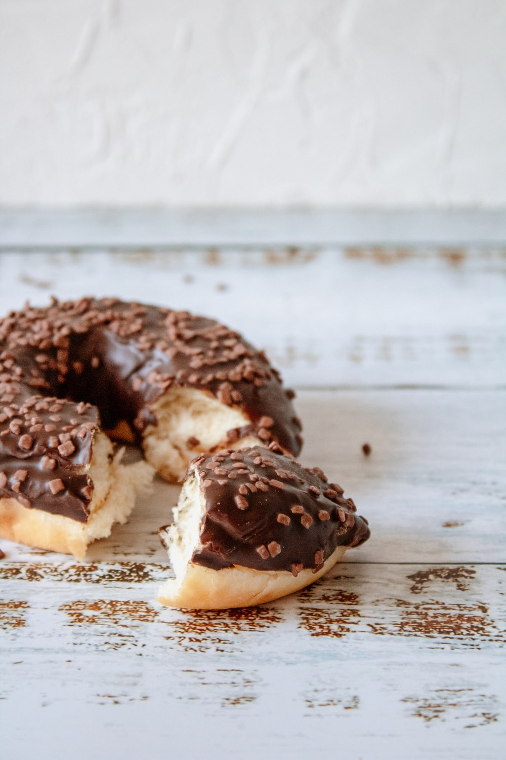 brown and white doughnut on white paper