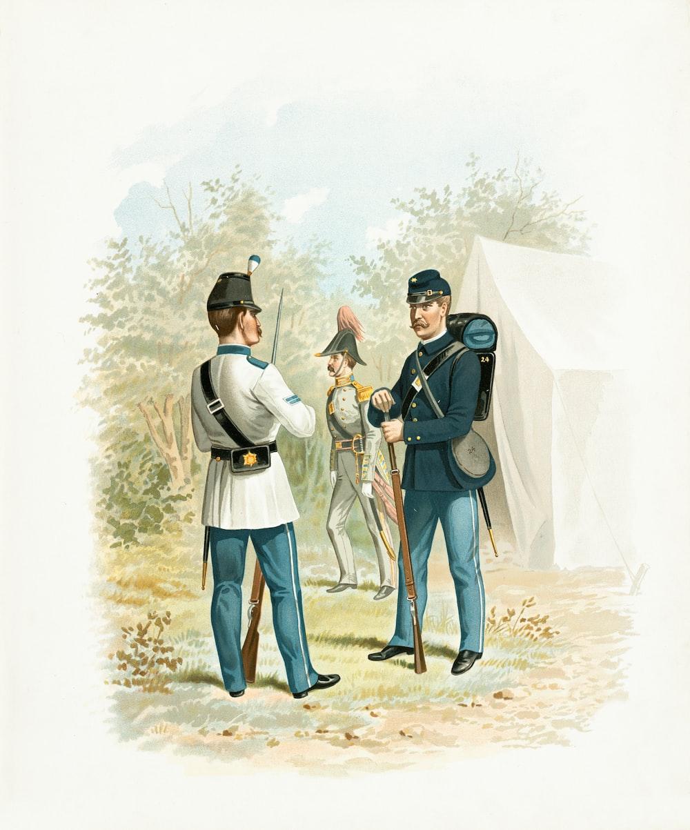 man in white long sleeve shirt standing beside man in black hat