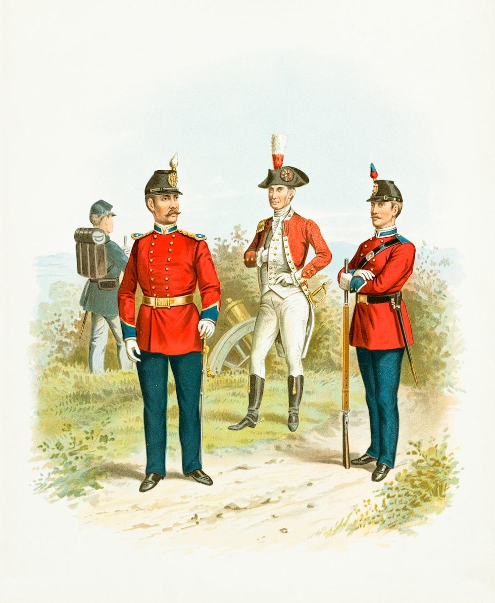 3 men in cowboy hat standing on sand