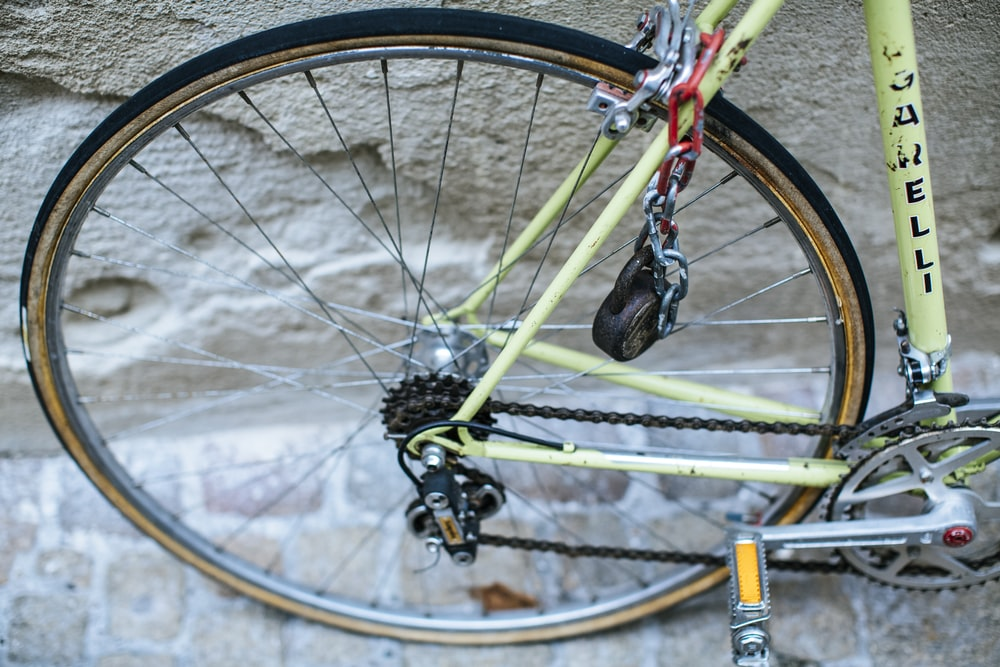 yellow bicycle wheel with tire