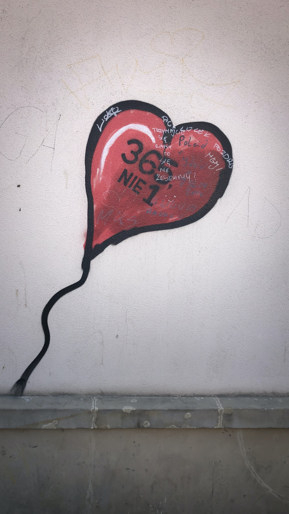red and white heart shape balloon