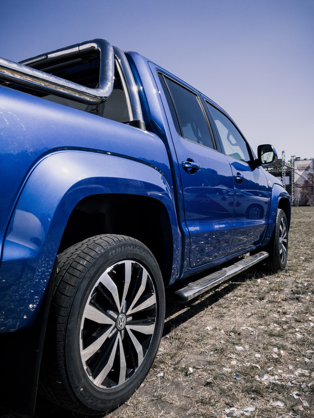 blue suv on gray dirt ground during daytime