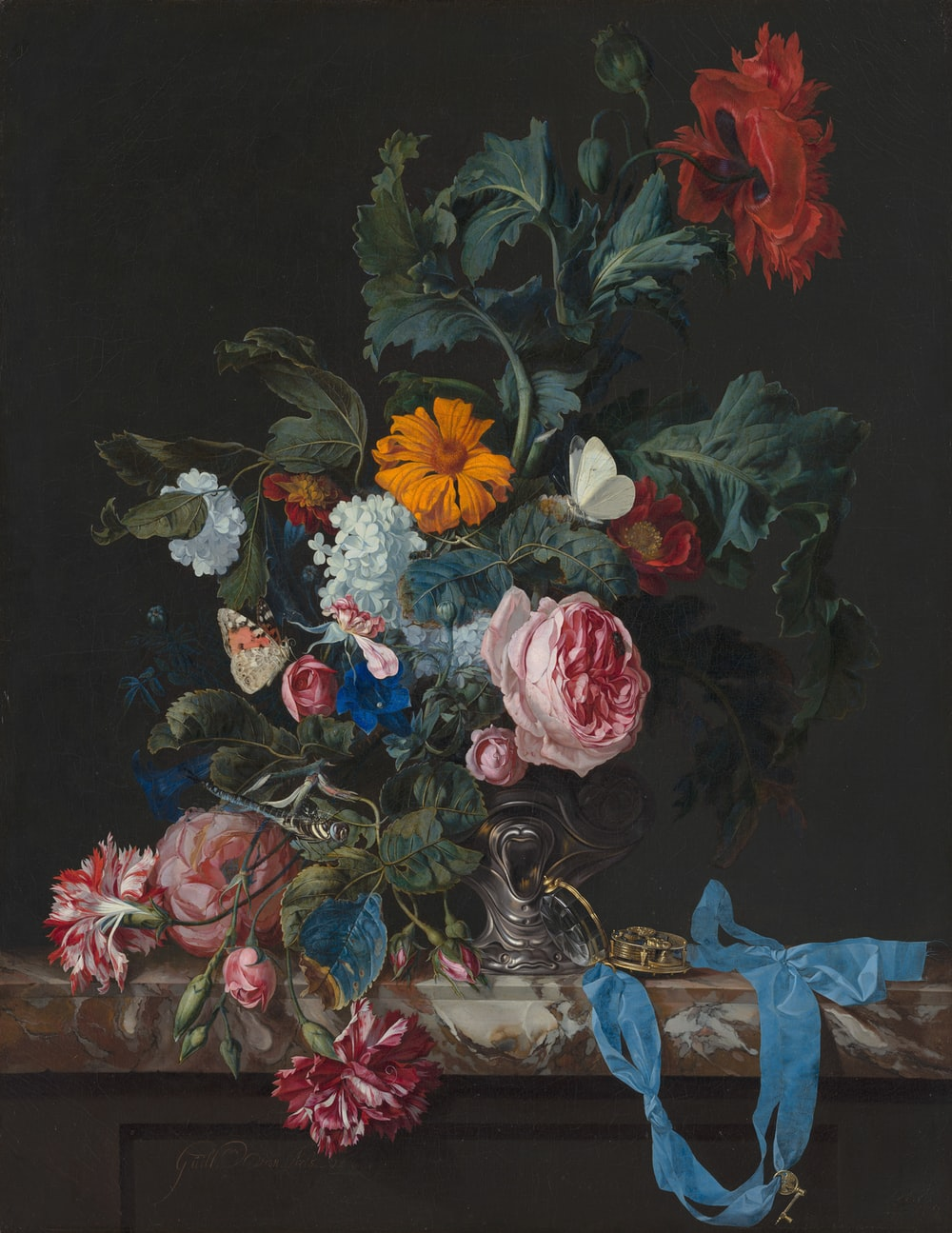 red and blue roses in vase