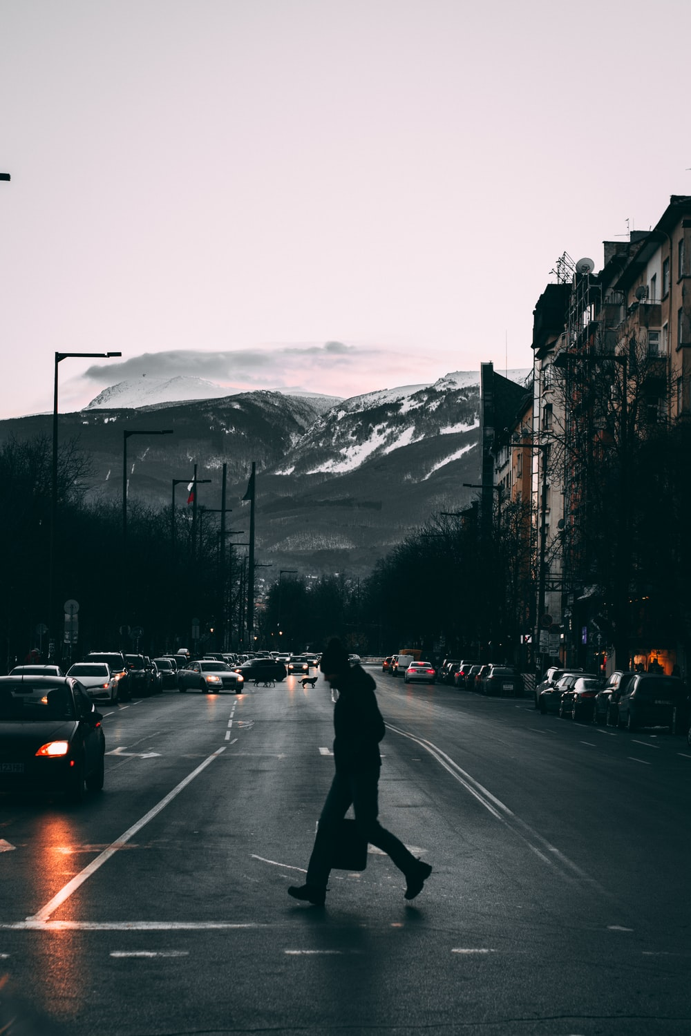 people walking on street near mountain during daytime