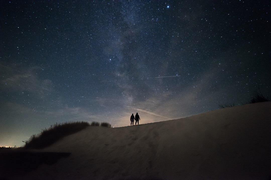 Couple Standing Under the Milkyway - unsplash