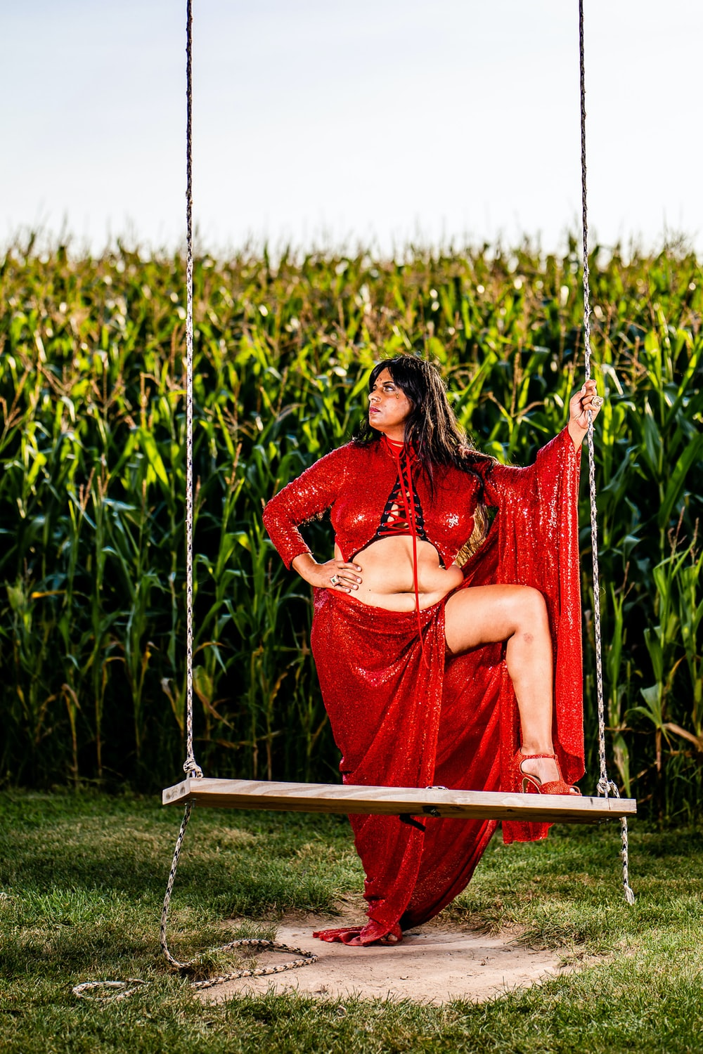 woman in red dress sitting on red hammock