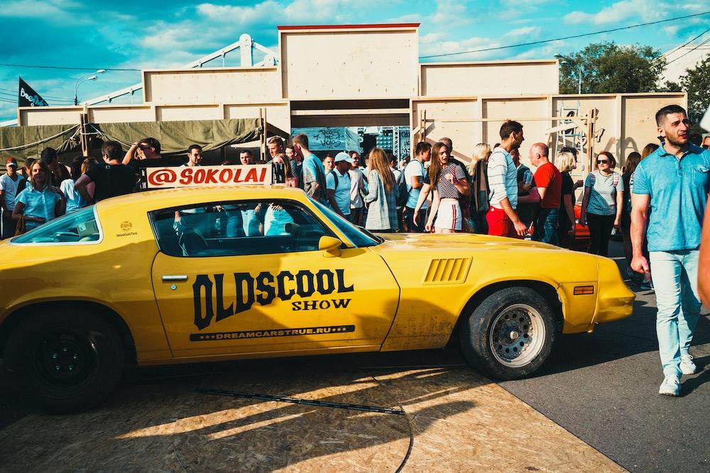 yellow porsche 911 parked on street