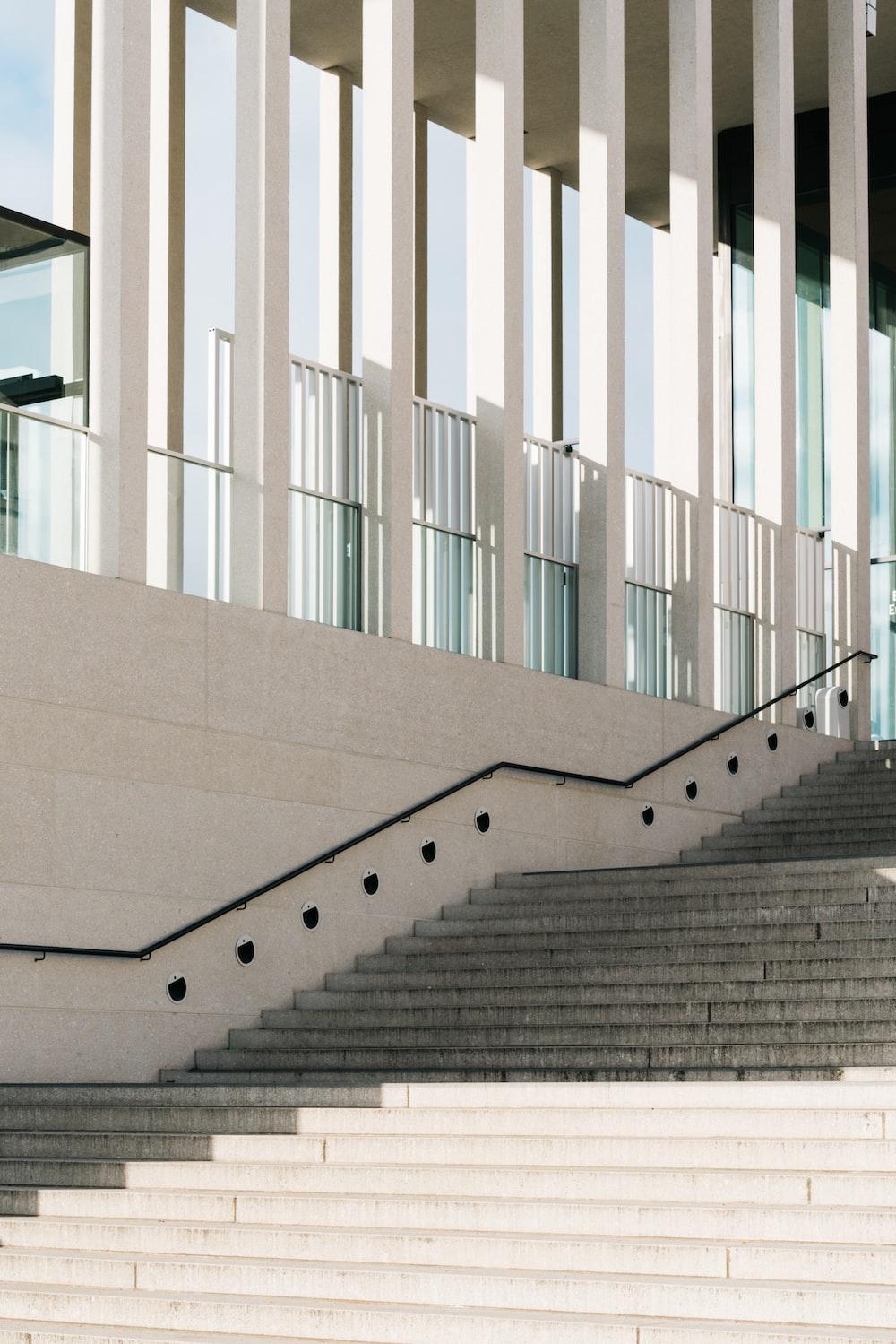 white concrete staircase with white metal railings