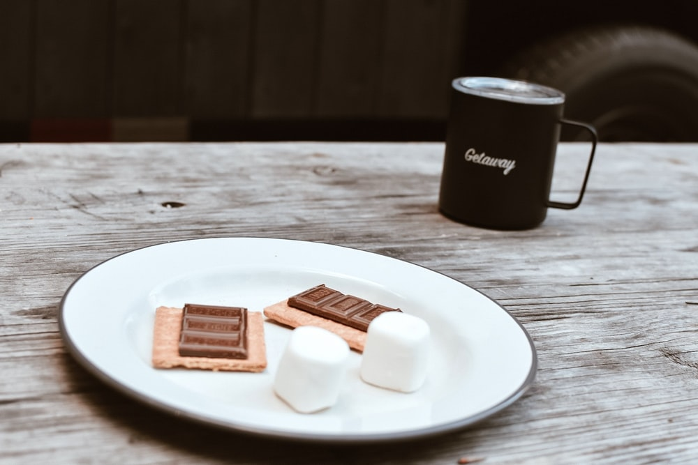 white ceramic plate with biscuits
