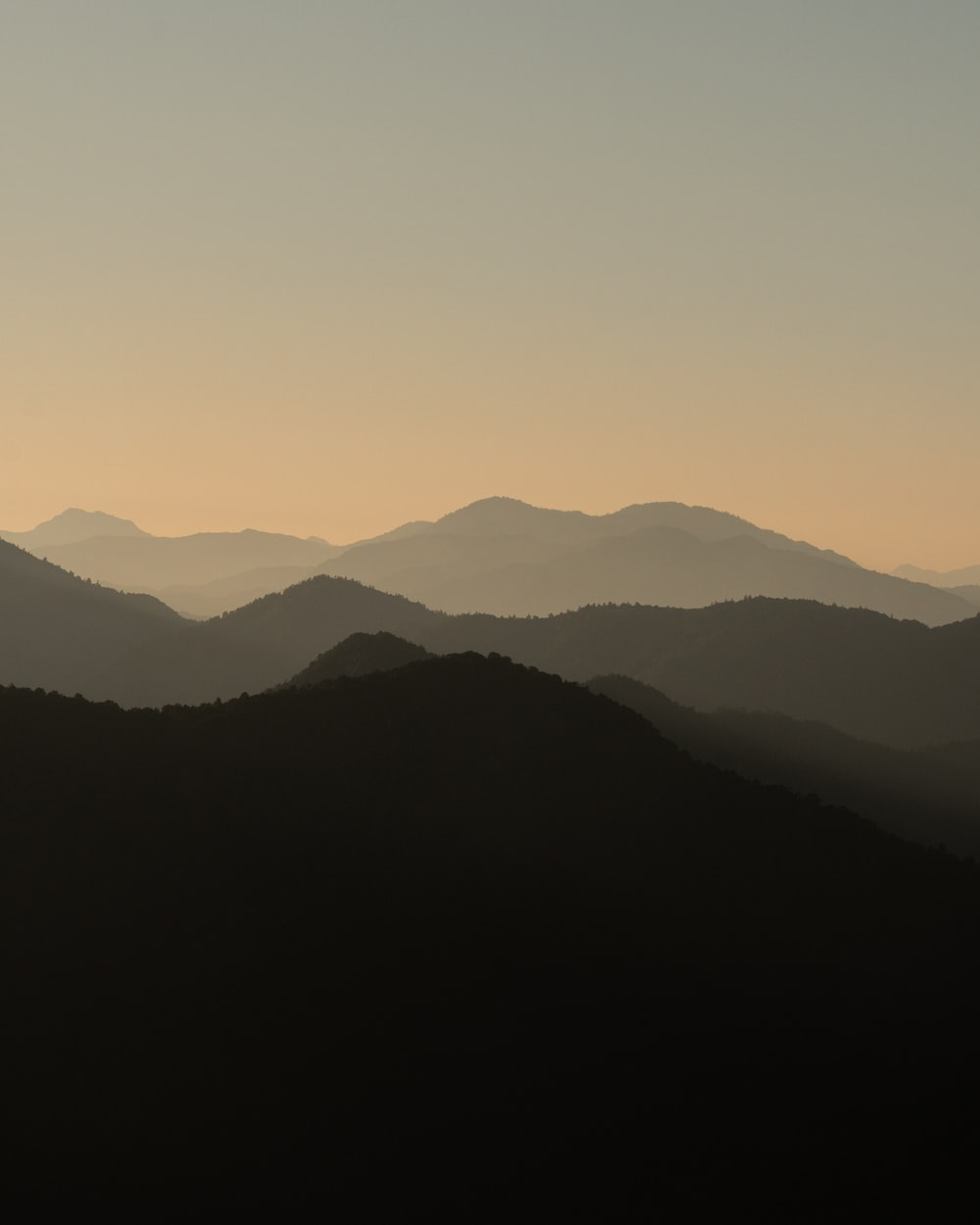 silhouette of mountains during daytime