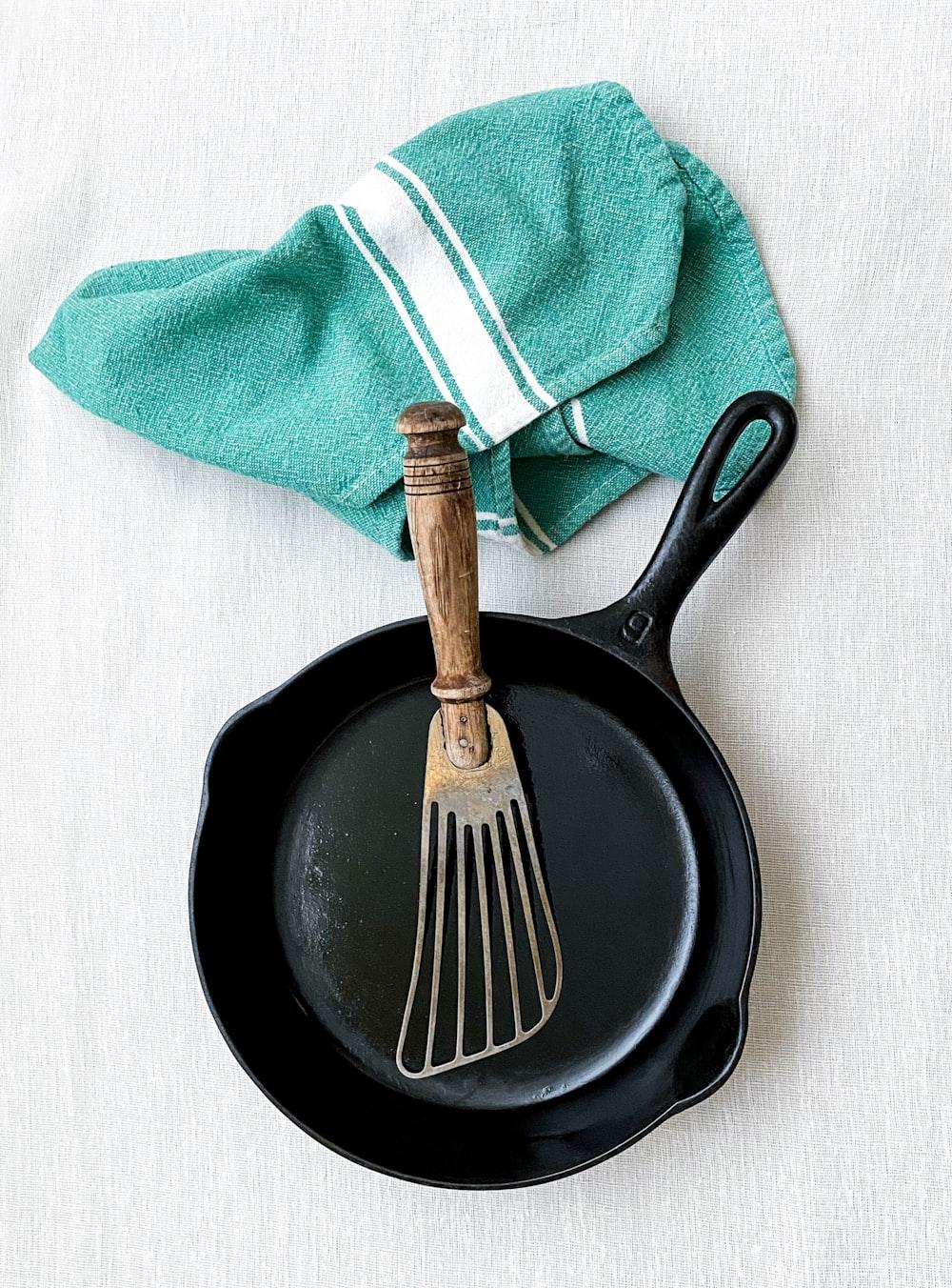 brown handle fork on black round plate