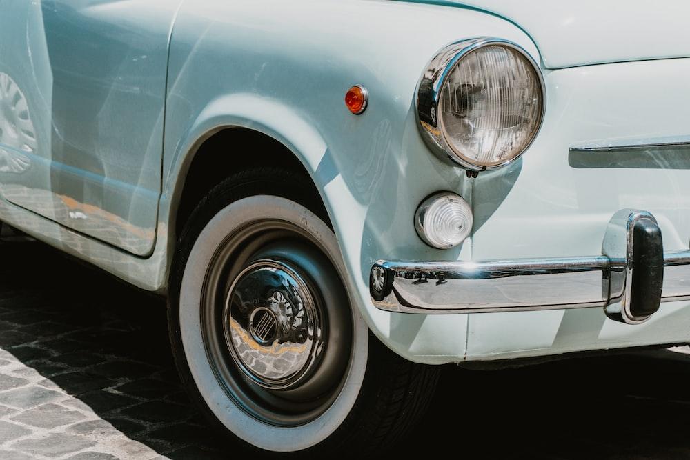 white car with chrome wheel