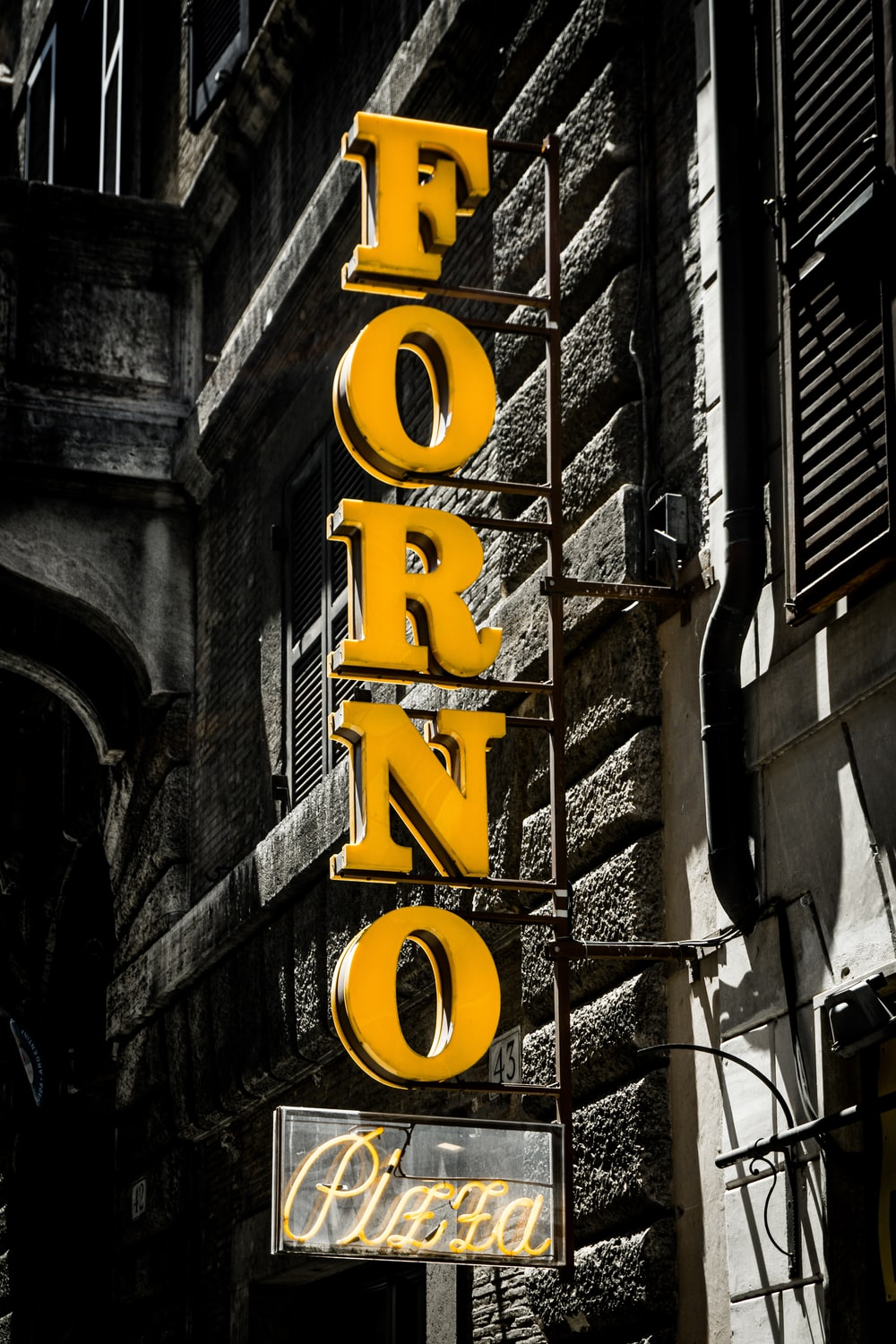 yellow and black love neon light signage