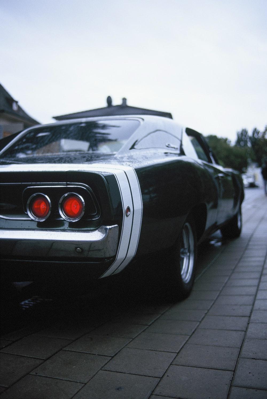 black porsche 911 parked on gray pavement