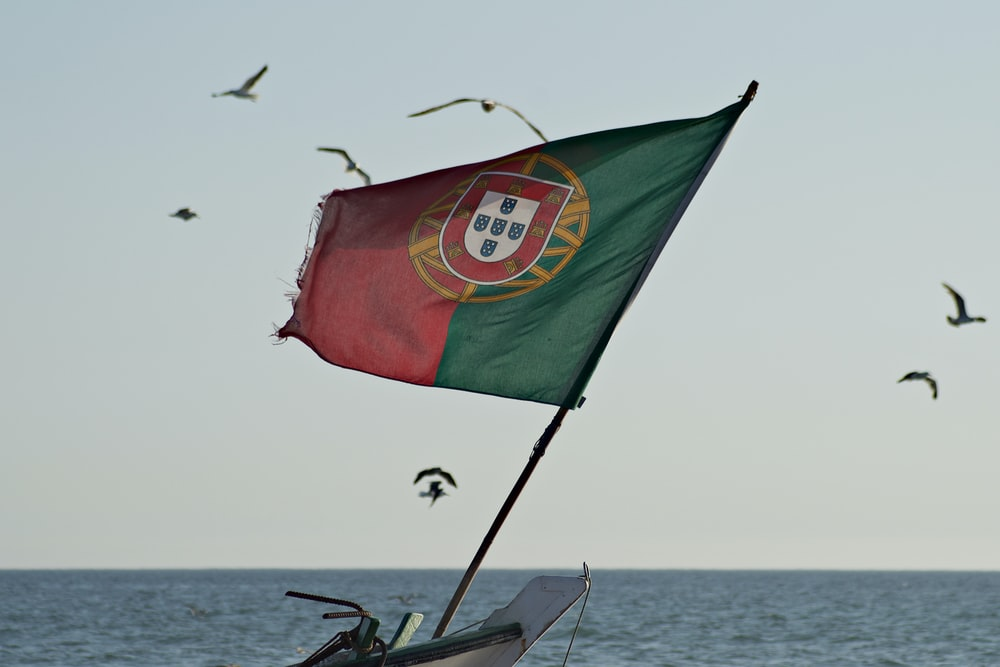 green red and yellow flag on boat during daytime