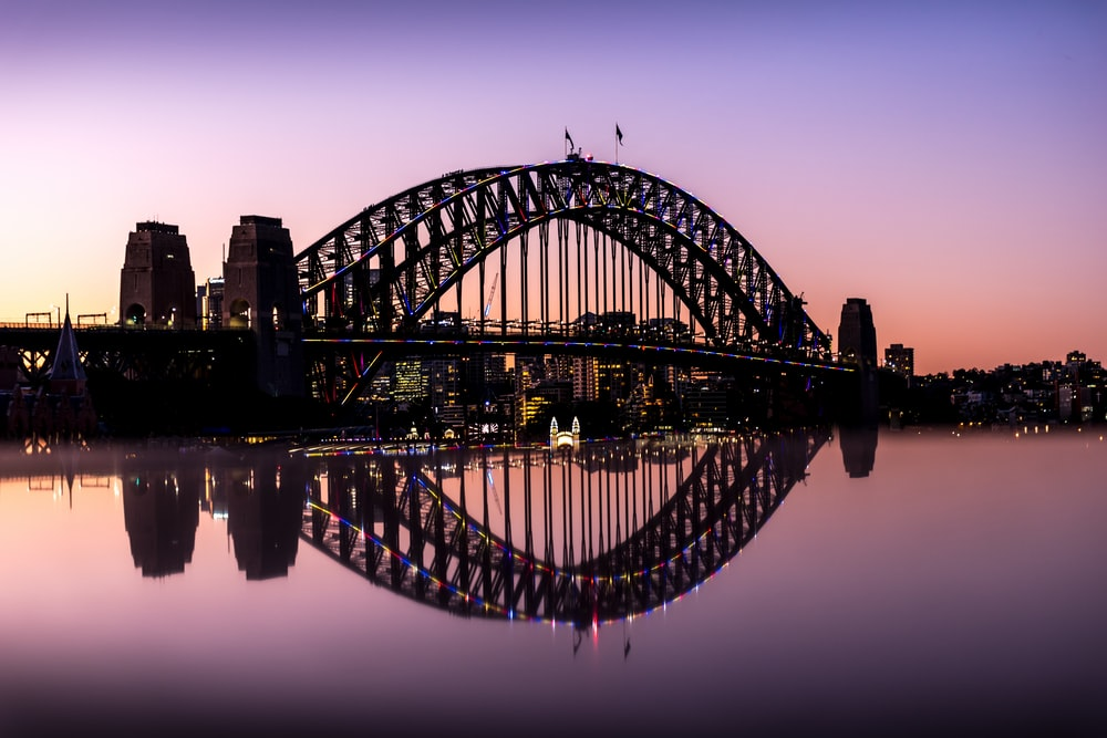 brown metal bridge over the river