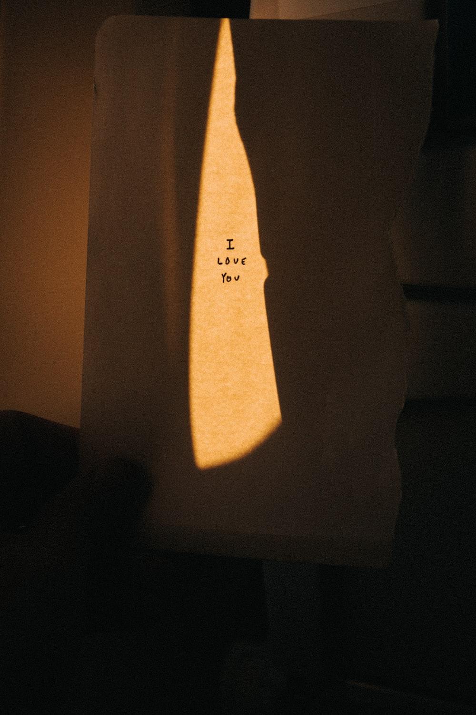 white textile with black text