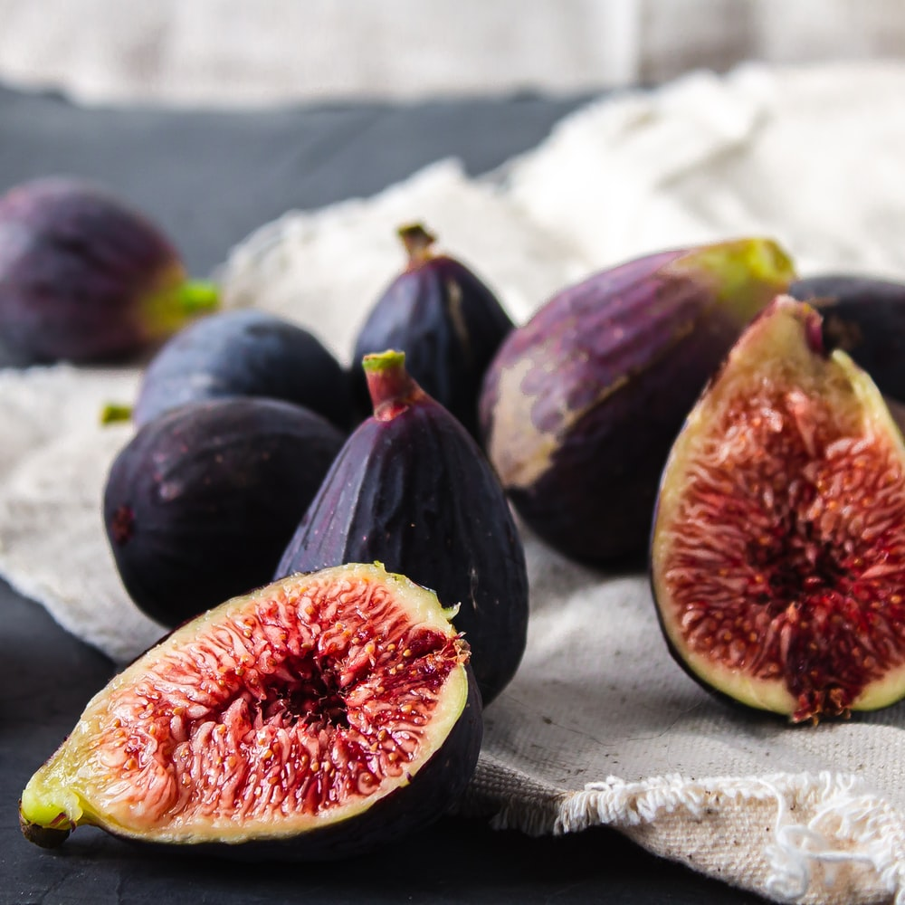 purple and red round fruit