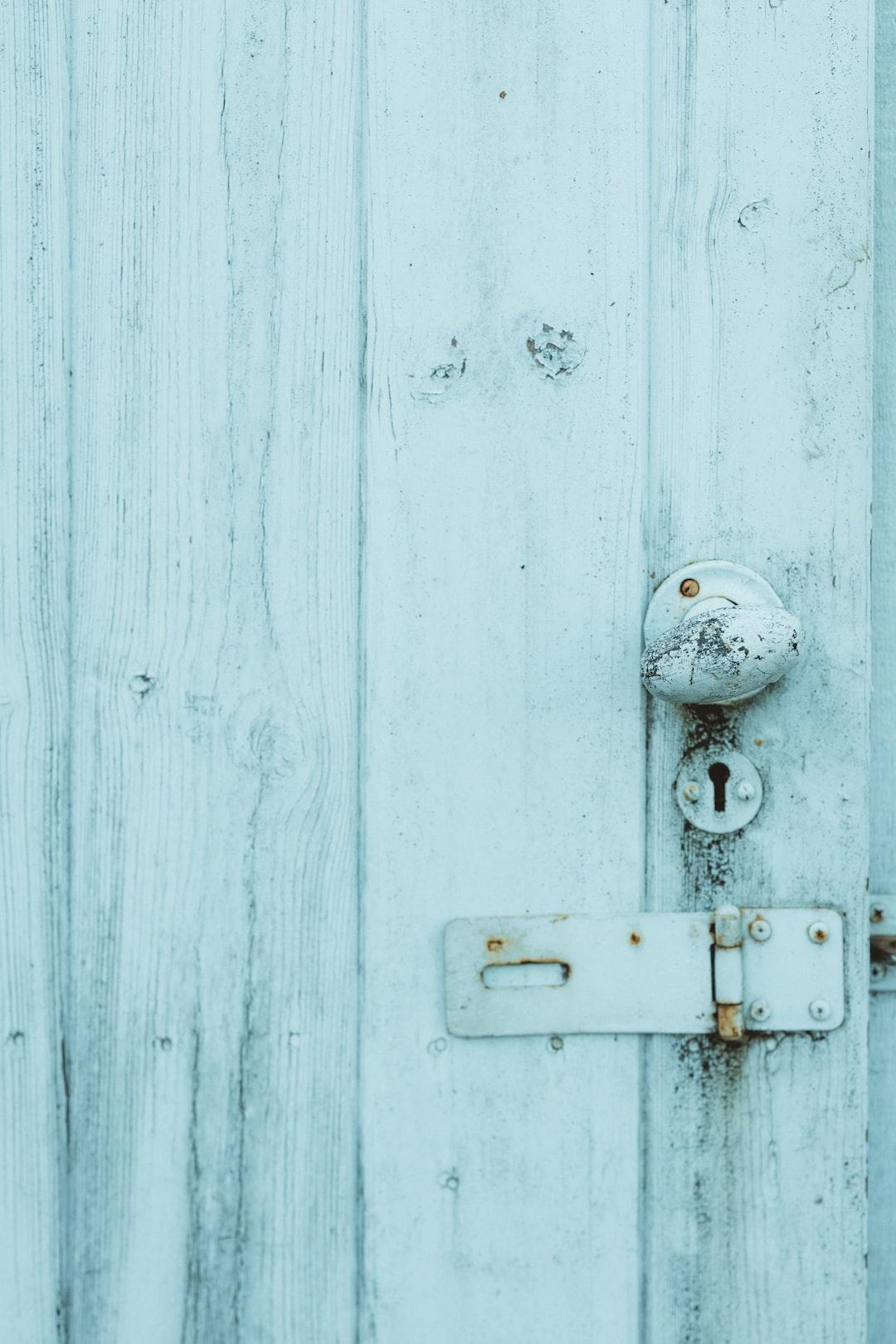 Pale blue distressed door with handle