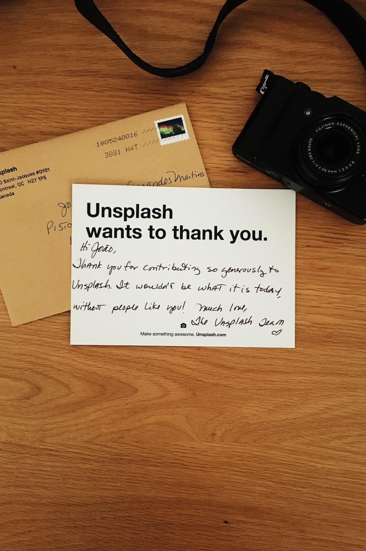 black camera beside brown envelope