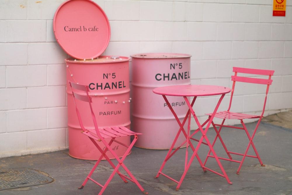 pink metal stool beside white wall