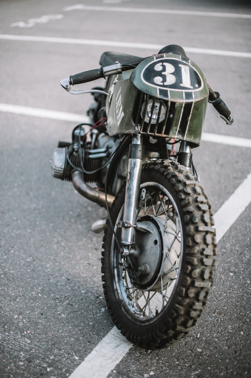 black and green motorcycle on road
