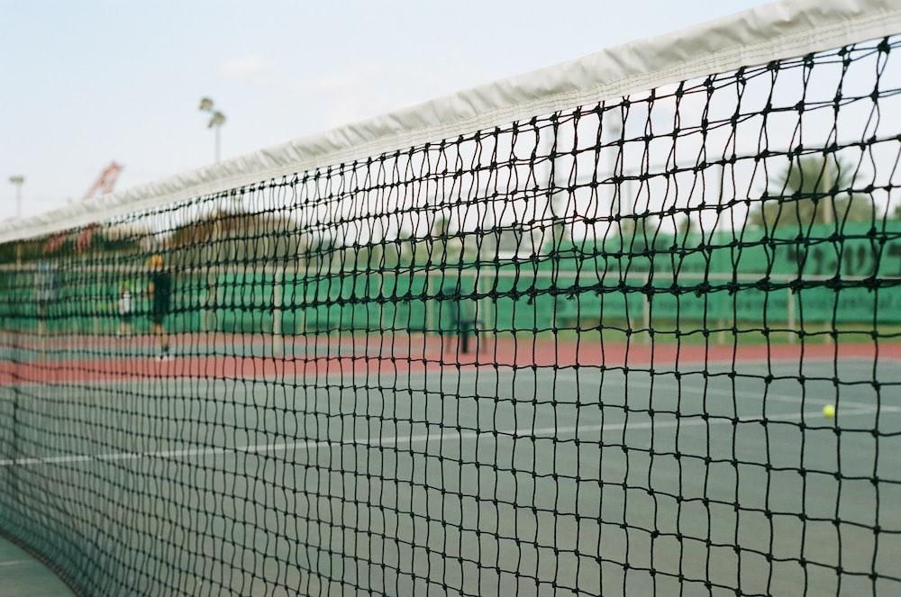 soccer goal net under blue sky during daytime