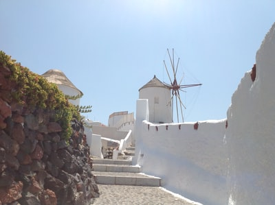 white and brown concrete building near green trees during daytime santorini zoom background