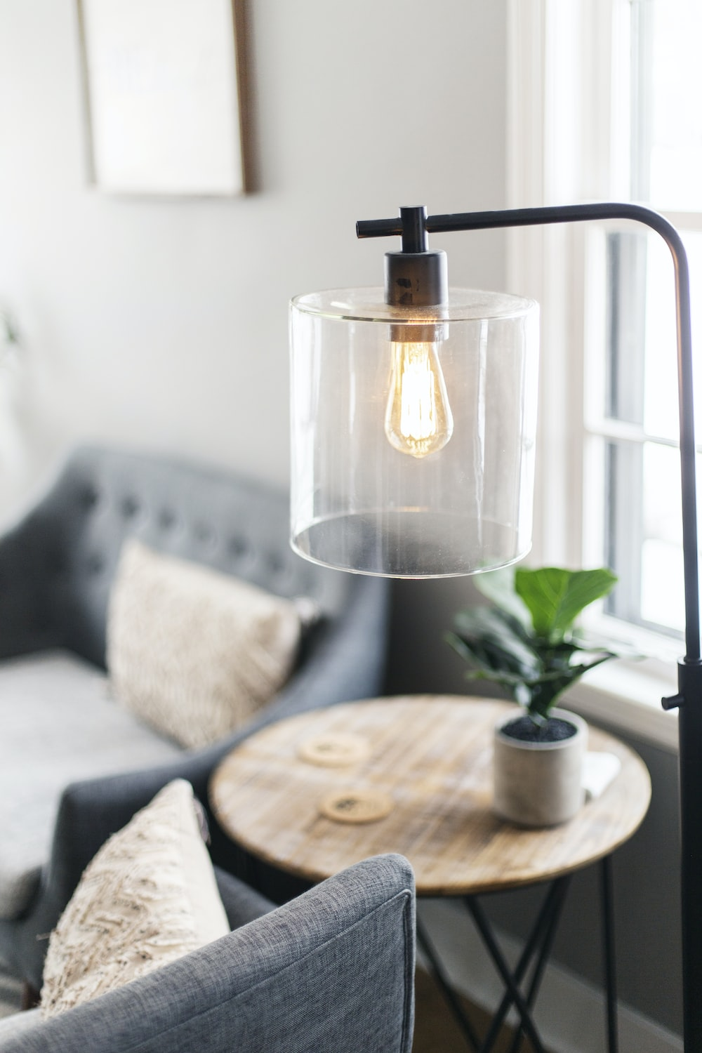 clear glass lamp on table
