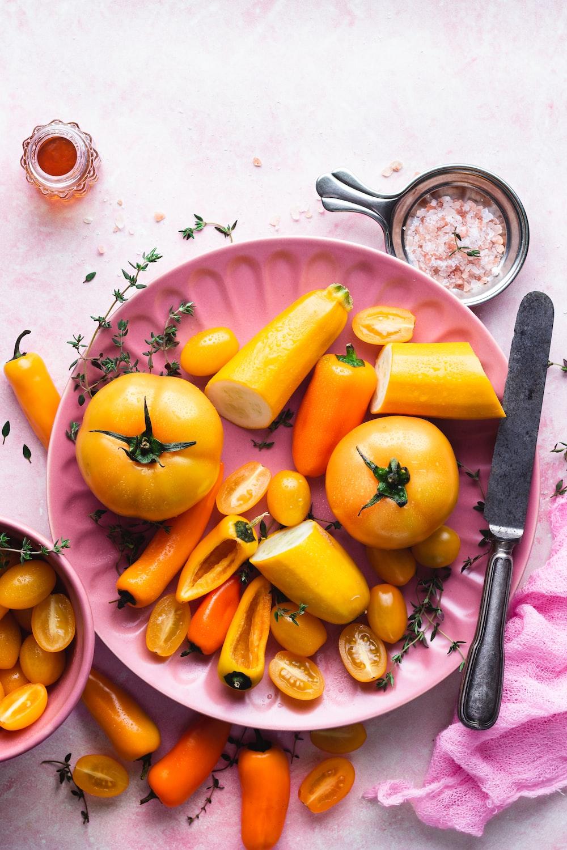 sliced orange fruit on purple plate