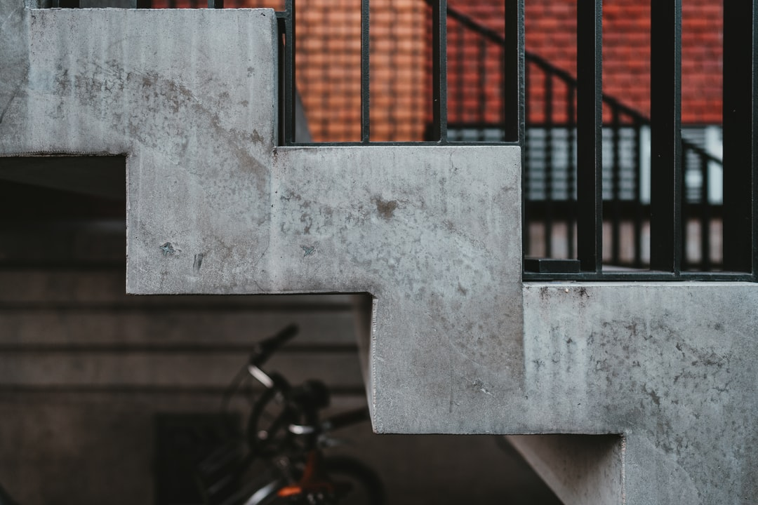 Black Bicycle Parked Beside White Concrete Wall - unsplash