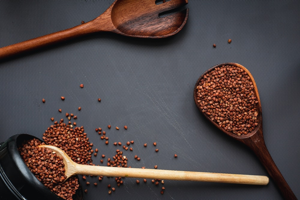 brown wooden spoon with brown powder