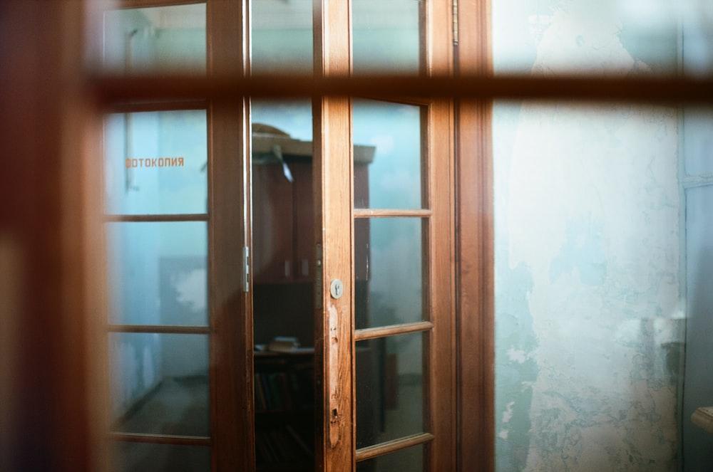 brown wooden framed glass door