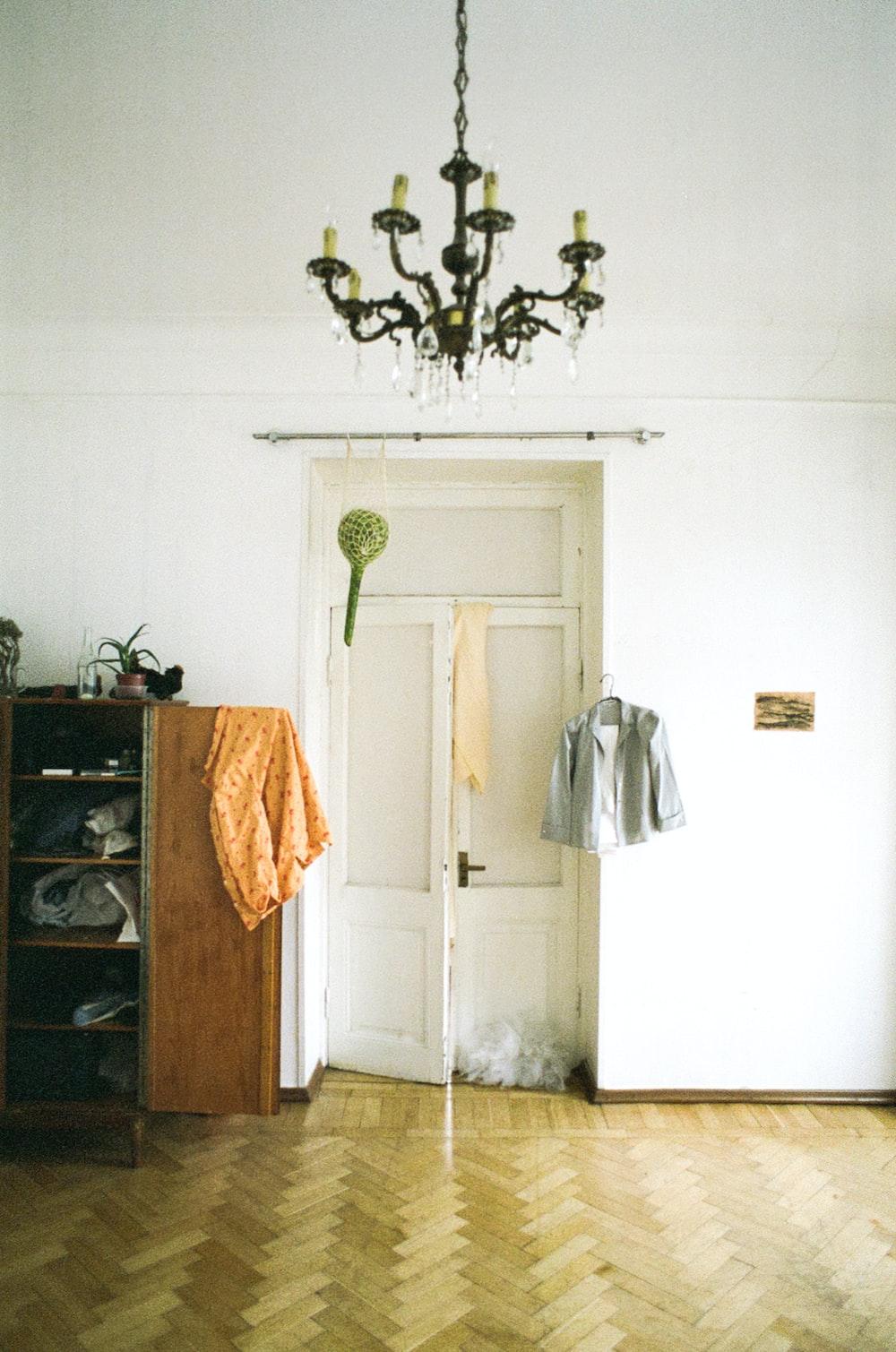 brown towel hanging on door