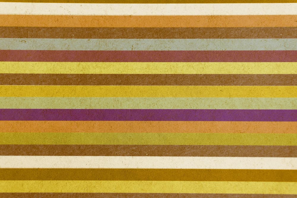 yellow red and white striped textile