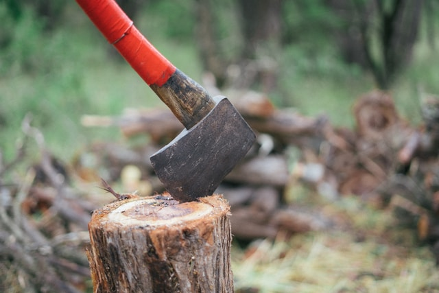 red and black axe on brown wood log
