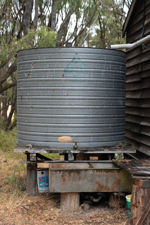 black round metal tank on brown wooden table