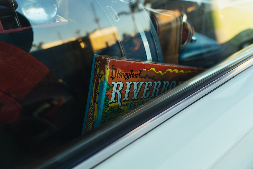 An Old Board Game Resting In A Classic Car.  - unsplash